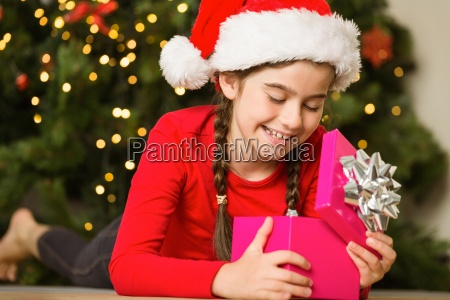 little girl opening a gift at