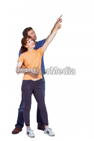 happy couple pointing upwards together