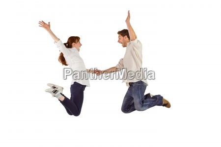 couple jumping and holding hands