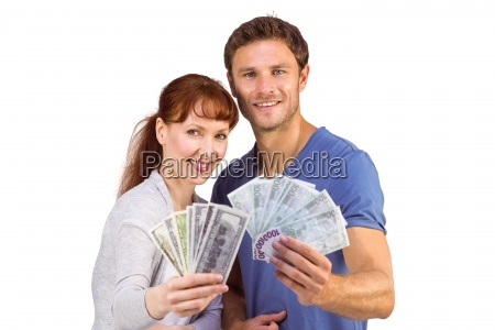 couple, holding, fans, of, cash - 13754047