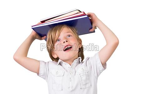 student balancing books on his head