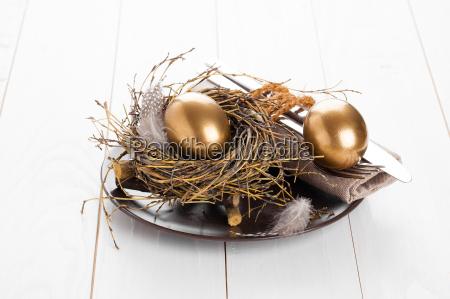 golden egg table decoration on white