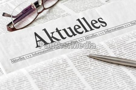 newspaper with the headline updates
