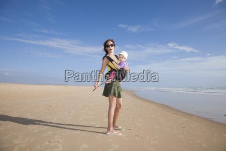 miniskirt mom with baby in rucksack