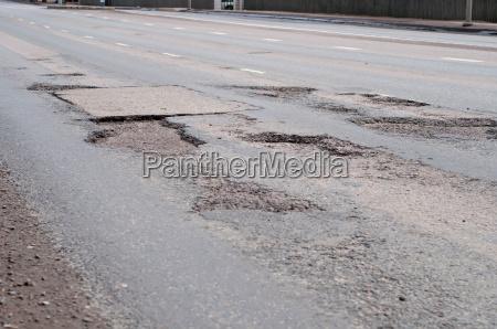 big hole in street asphalt