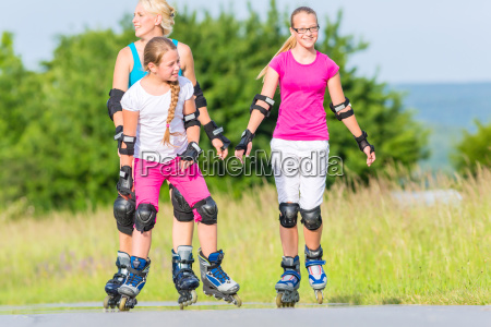 family skating with inline skates on