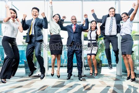 diversity business team jumping celebrating success