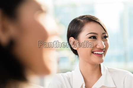 chinese business woman in team meeting