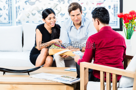 couple in furniture store with shop