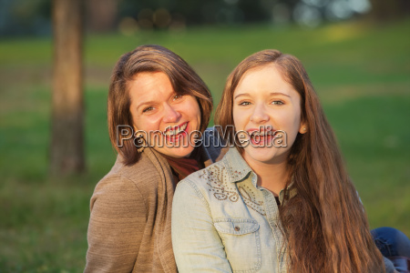 happy teen with mother