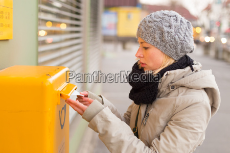 young lady posting letters