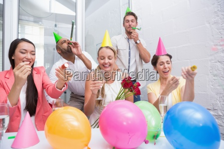 business team celebrating with champagne and
