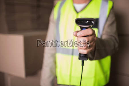 mid section of worker with scanner