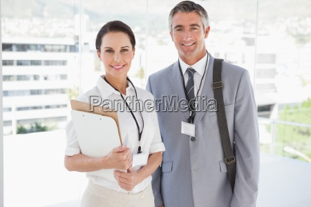 businessman standing with co worker