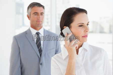 concentrated businesswoman using her phone
