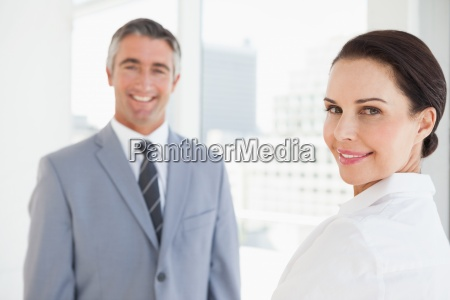 happy business woman looking at camera