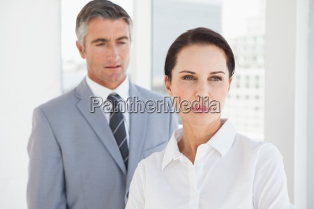 concentrated businesswoman looking away