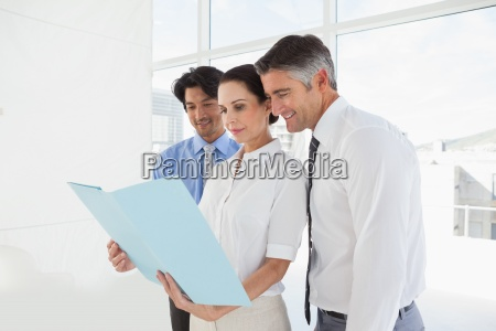 business team looking over files