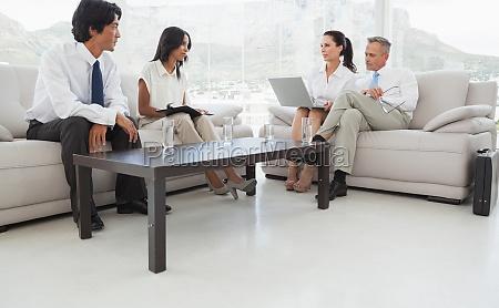 smiling team mates sitting together