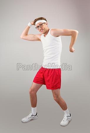 geeky hipster posing in sportswear