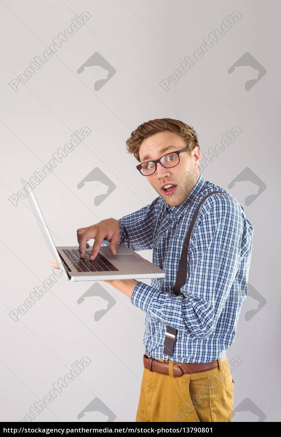 geeky, businessman, using, his, laptop - 13790801