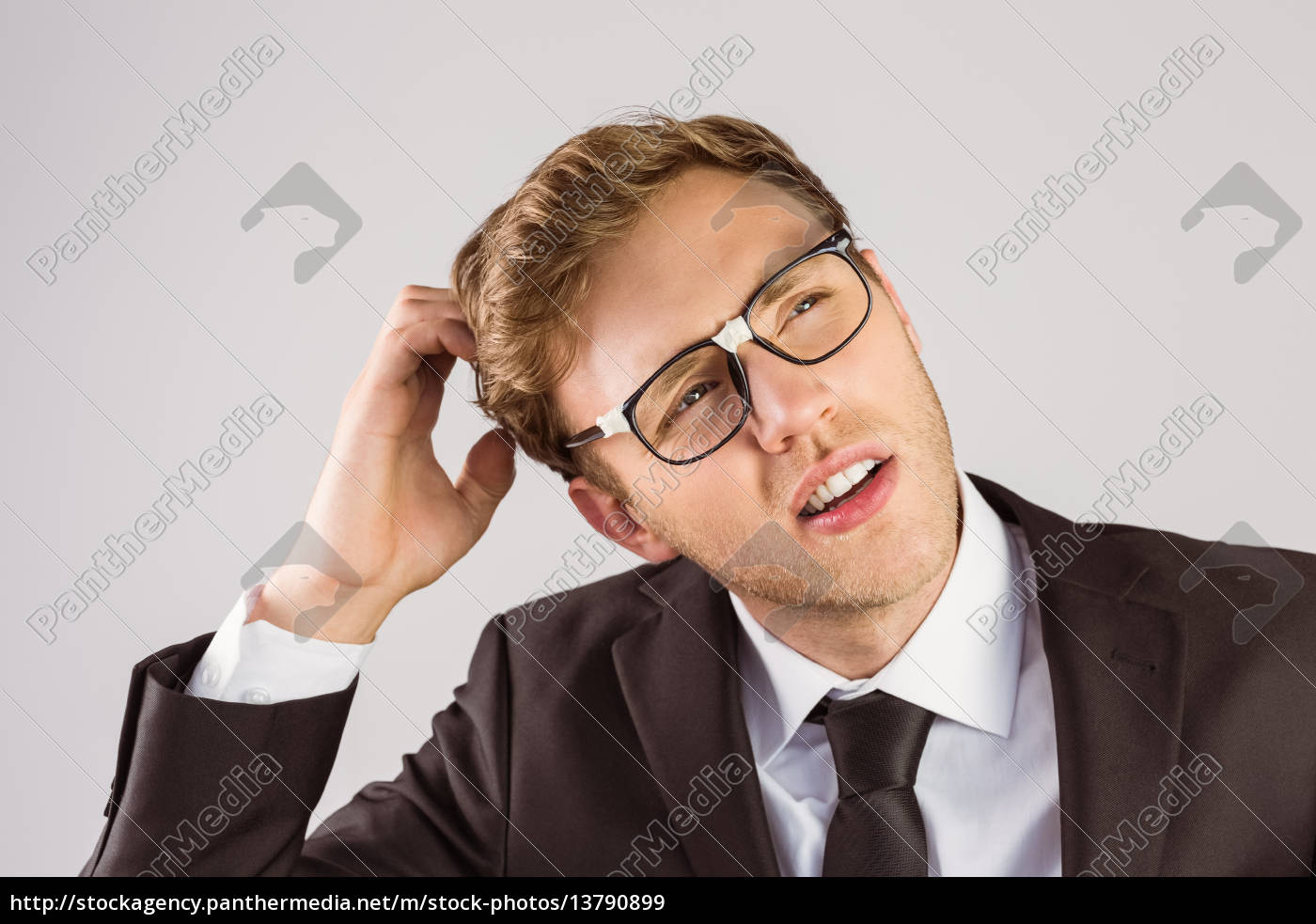 young, geeky, businessman, scratching, his, head - 13790899