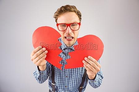 geeky hipster holding a broken heart