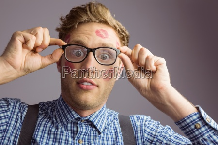 geeky hipster covered in kisses