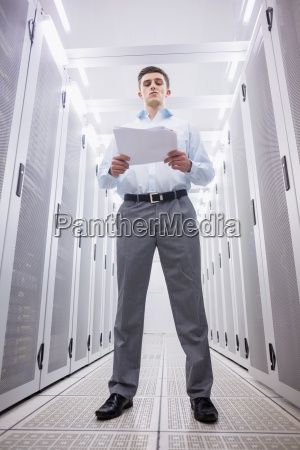 concentrated technician reading a document