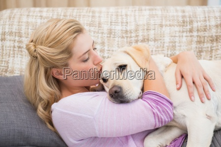 beautiful blonde on couch with pet