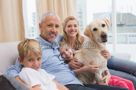 parents and their children on sofa