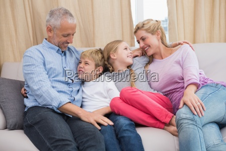 happy parents with their children on