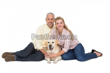 happy couple with their pet dog