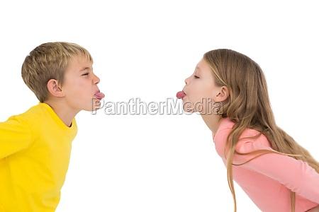 cute siblings teasing each other