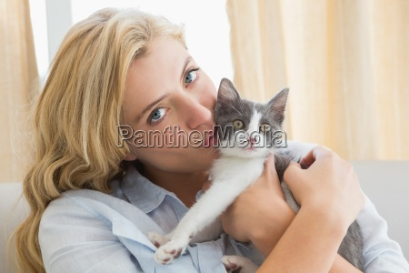 pretty blonde with pet kitten on