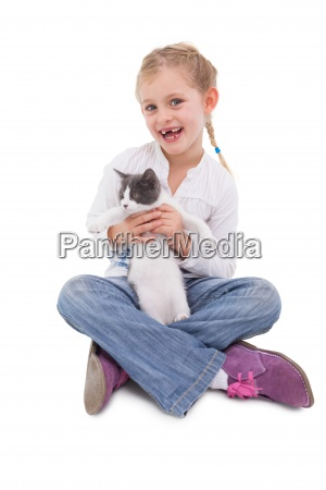 happy little girl sitting with cat