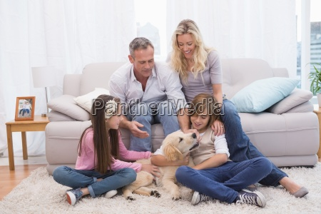smiling family with their pet yellow