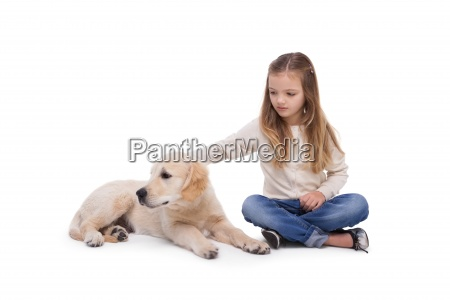 girl holding her puppy close