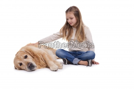 happy girl petting her dog