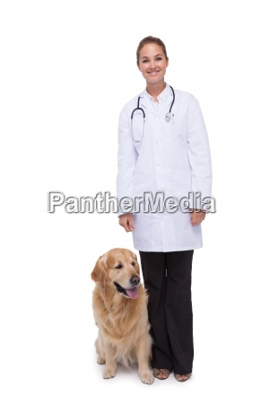 vet standing with a dog