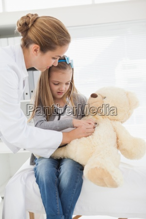 doctor giving a patient a stuffed
