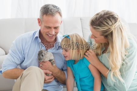 smiling, parents, and, daughter, sitting, with - 13794391