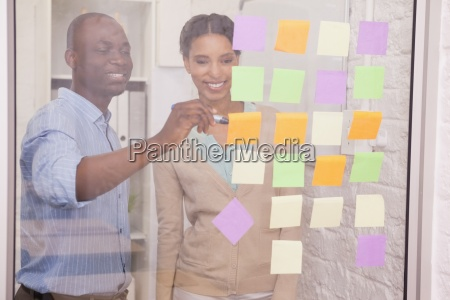 creative business team pointing adhesive notes