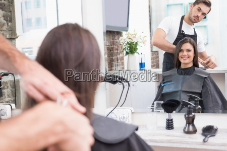 pretty brunette getting her hair cut