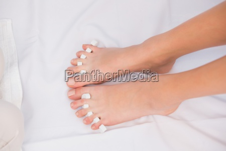 womans toes separated by toe separators
