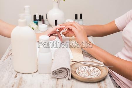 nail, technician, giving, customer, a, manicure - 13797293