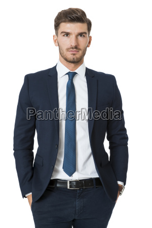 successful young businessman standing isolated in
