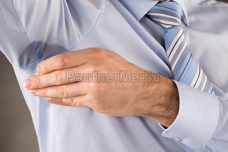 man sweating very badly under armpit