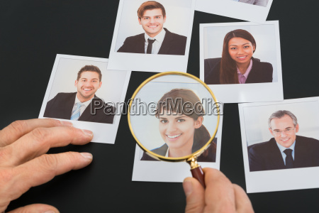 businessman looking at photograph through