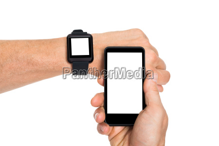 hand with smartwatch and cellphone